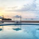 sunrise view of pool overlooking ocean